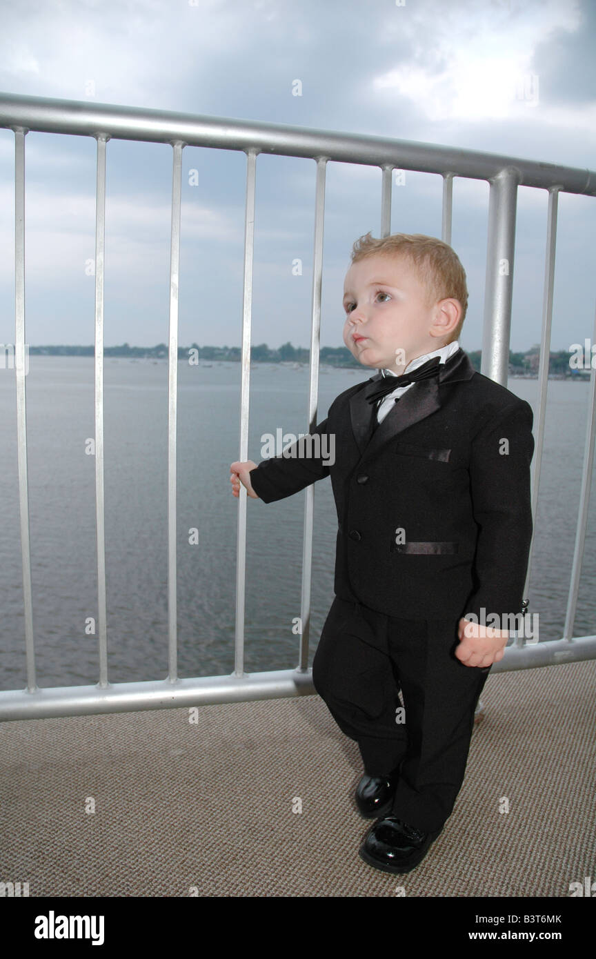 a 1 year old toddler posing on a deck in formal tuxedo Stock Photo ...