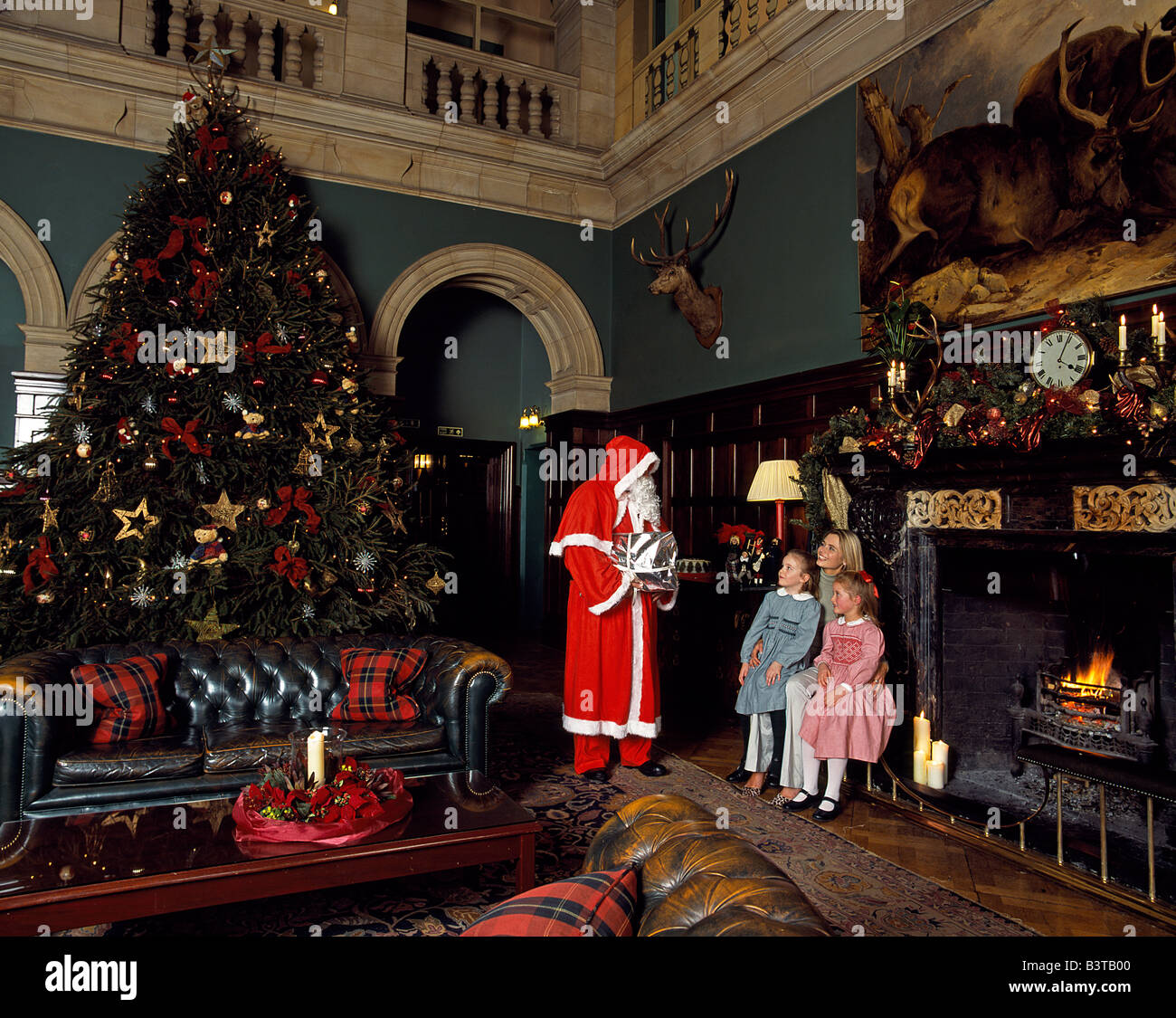 England, Leicestershire, Stapleford. Father Christmas Visits A Family  Staying At Stapleford Park Country