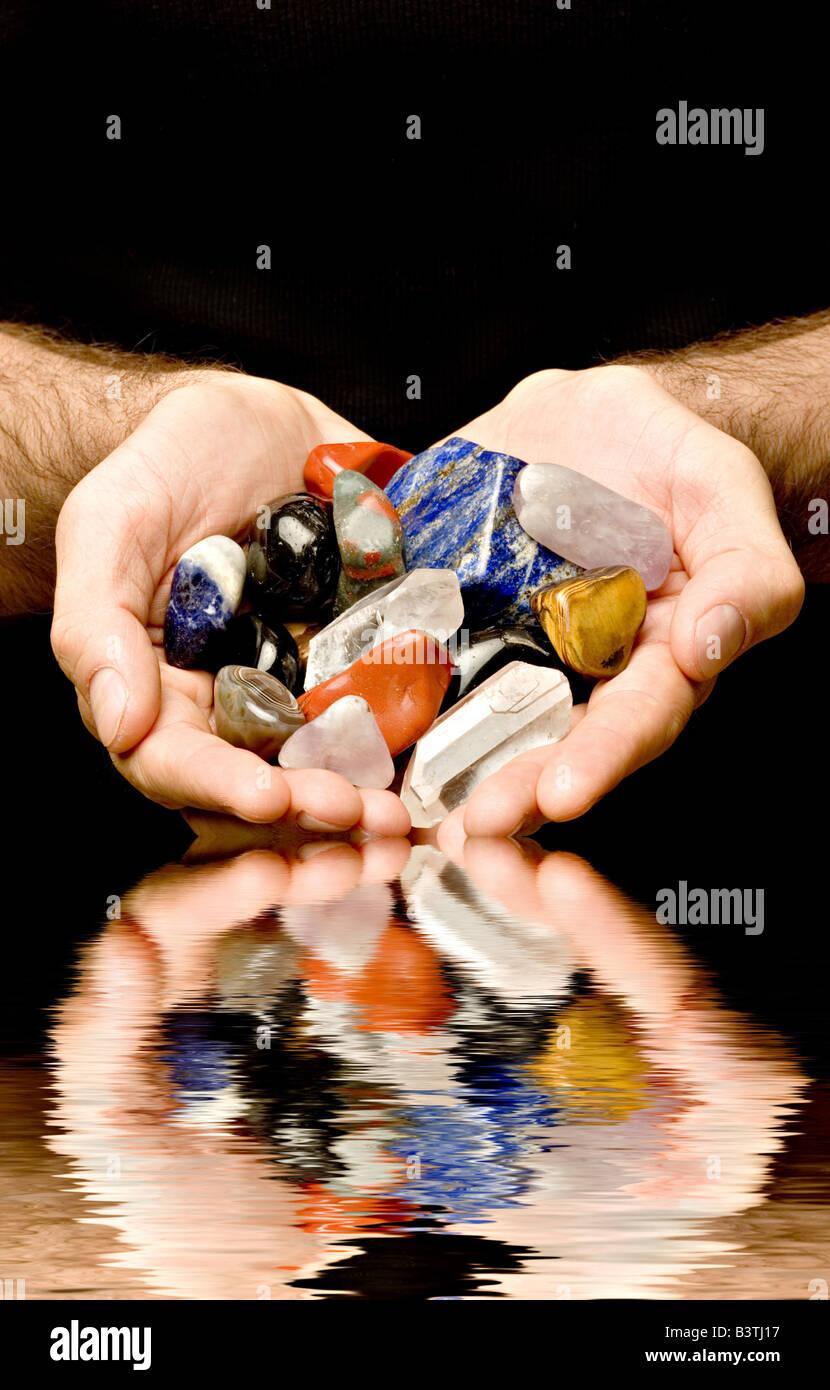 gemstones in the hands - Stock Image
