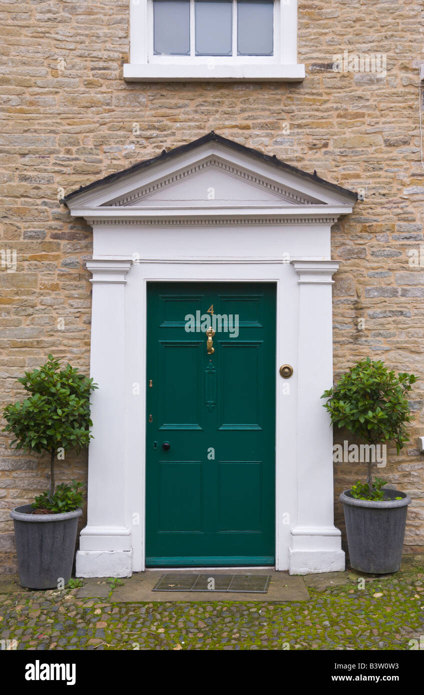Bon Green Front Door With White Triangular Pediment Of Townhouse In Ludlow  Shropshire England UK With Feature Shrubs