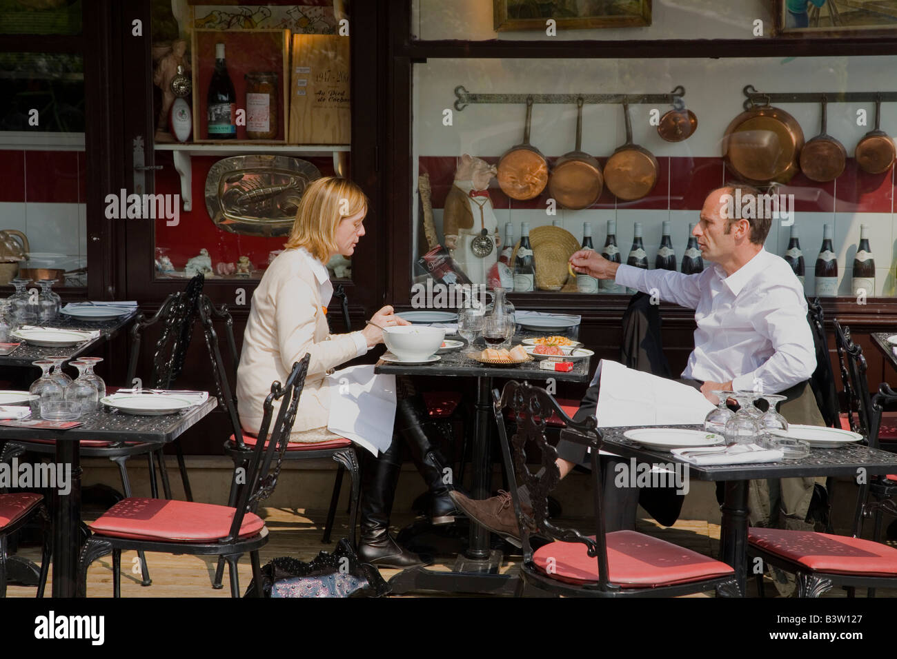 French chefs enjoy alfresco lunch in pavement cafe restaurant France Europe EU - Stock Image