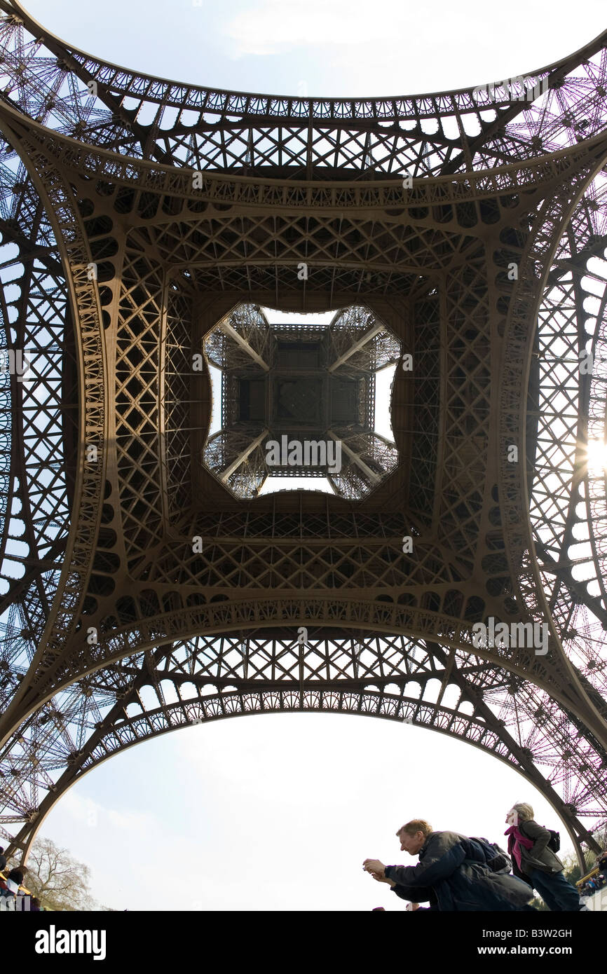 Eiffel Tower wide angle fish eye under underneath looking up view day daytime daylight Paris France Europe EU - Stock Image