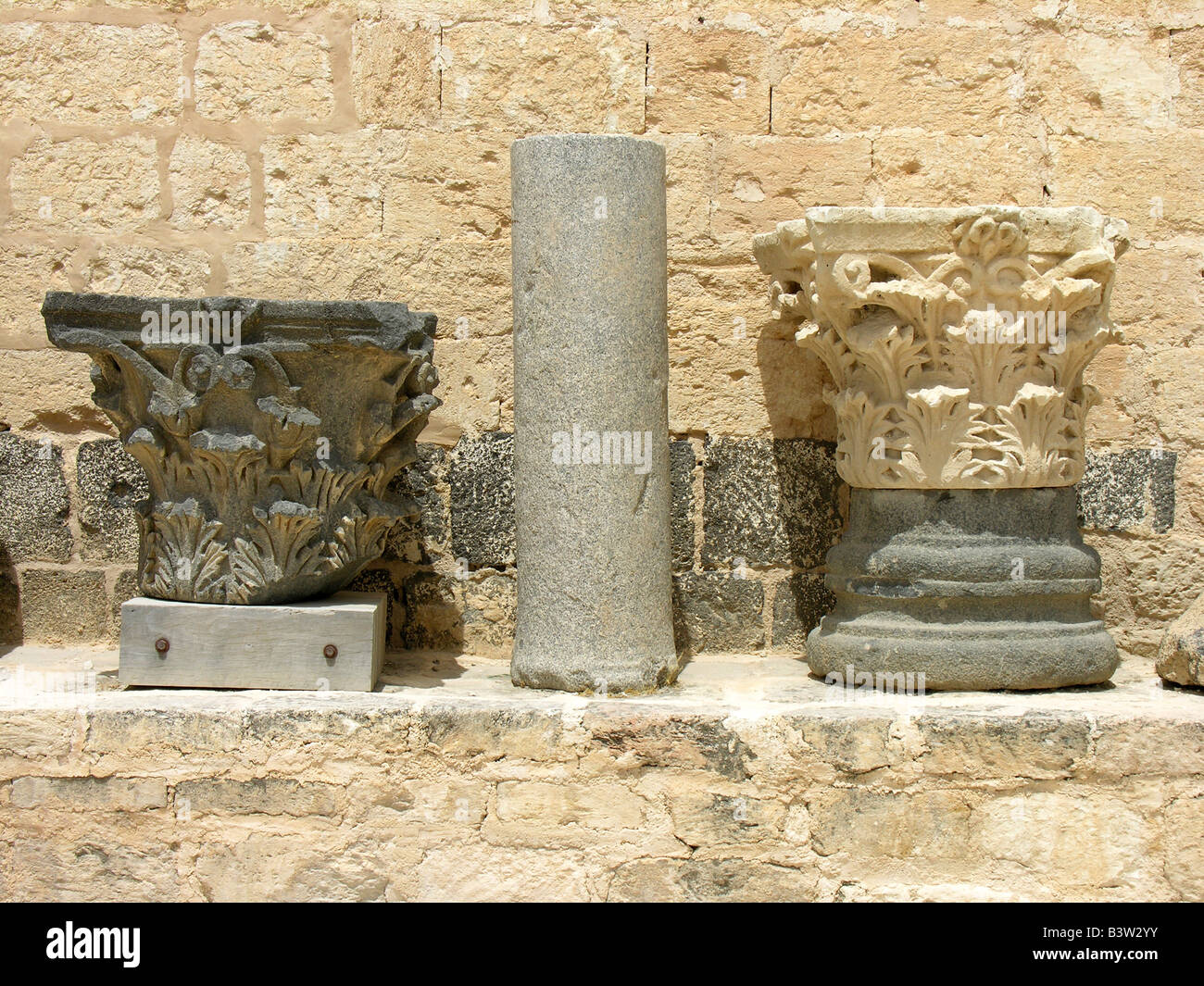 Acanthus leaves carved into pillar bases at the Roman city of Jerash north of Amman Jordan - Stock Image