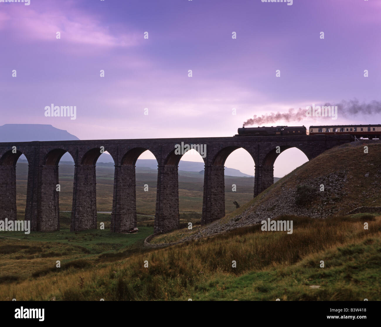 Steam train crosses Ribblehead Viaduct railway North Yorkshire dales - Stock Image