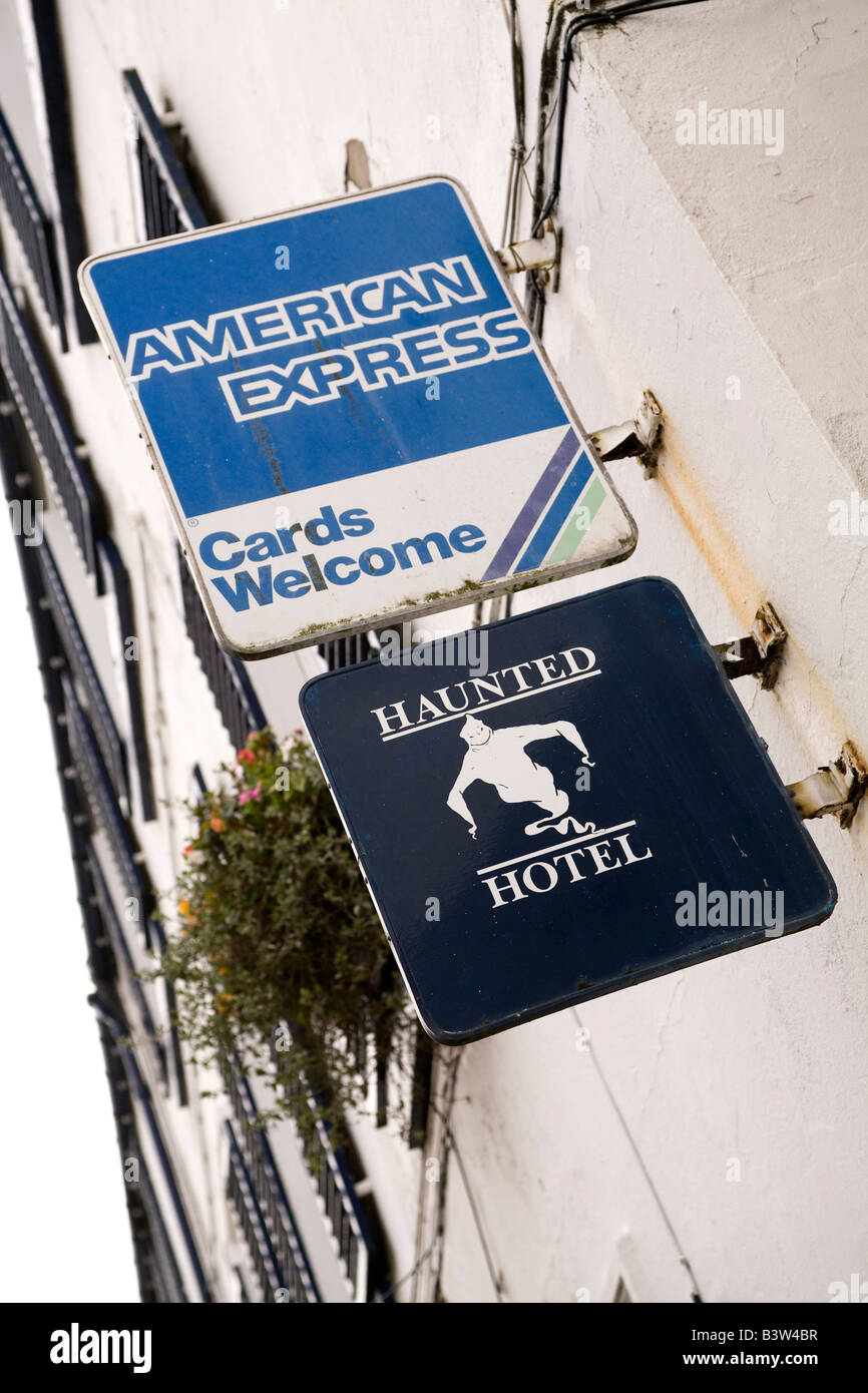 The sign for a haunted hotel in Alnmouth in Northumberland, Engla The sign above says American Express cards will - Stock Image