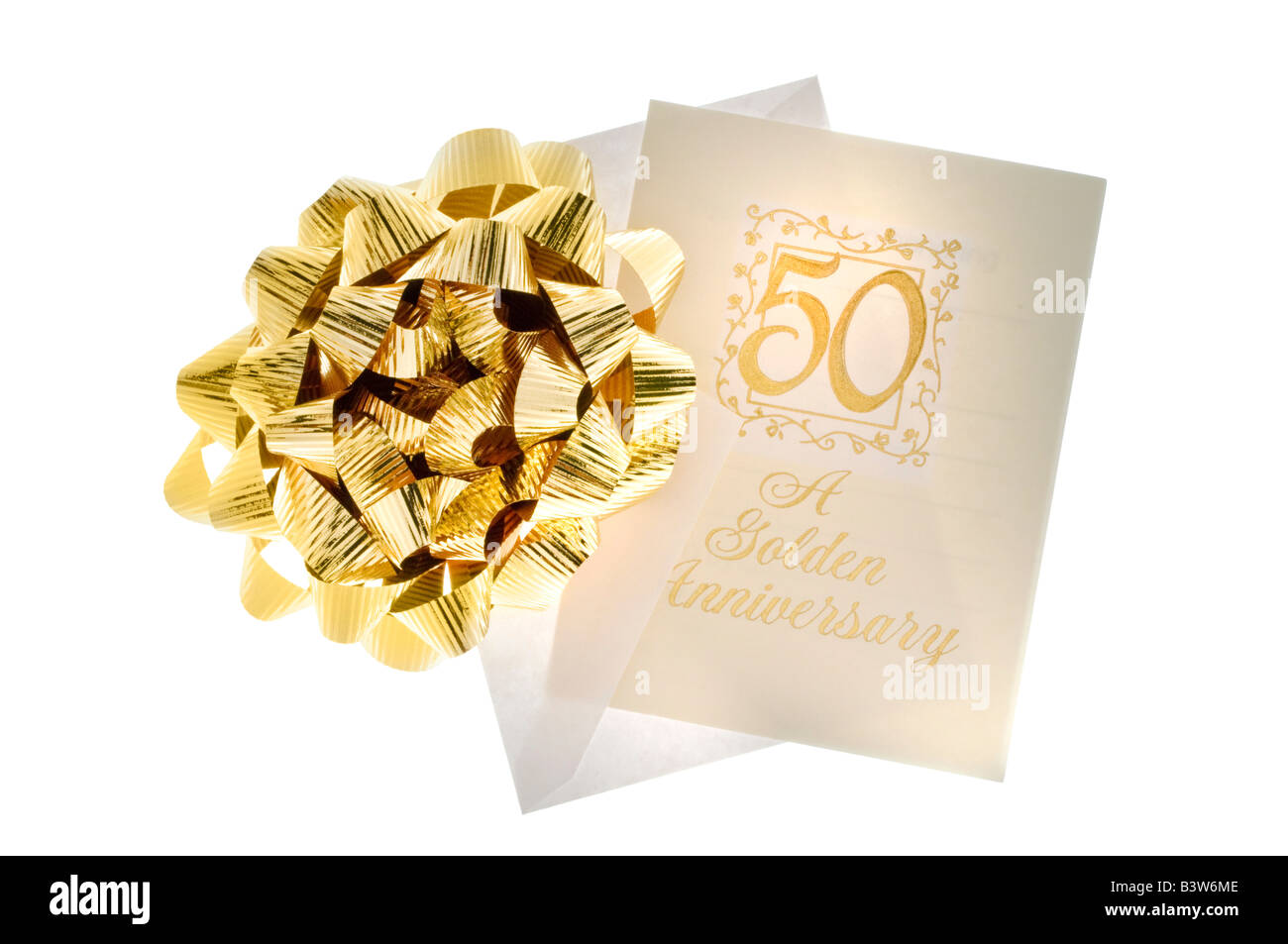 50th Anniversary card with envelope and gold bow - Stock Image