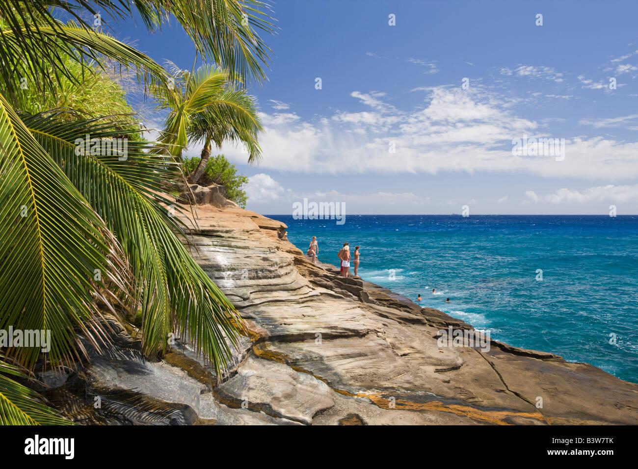 Tourists at Chinawall Rocks at Kawaihoa Point Oahu Pacific Ocean Hawaii USA - Stock Image