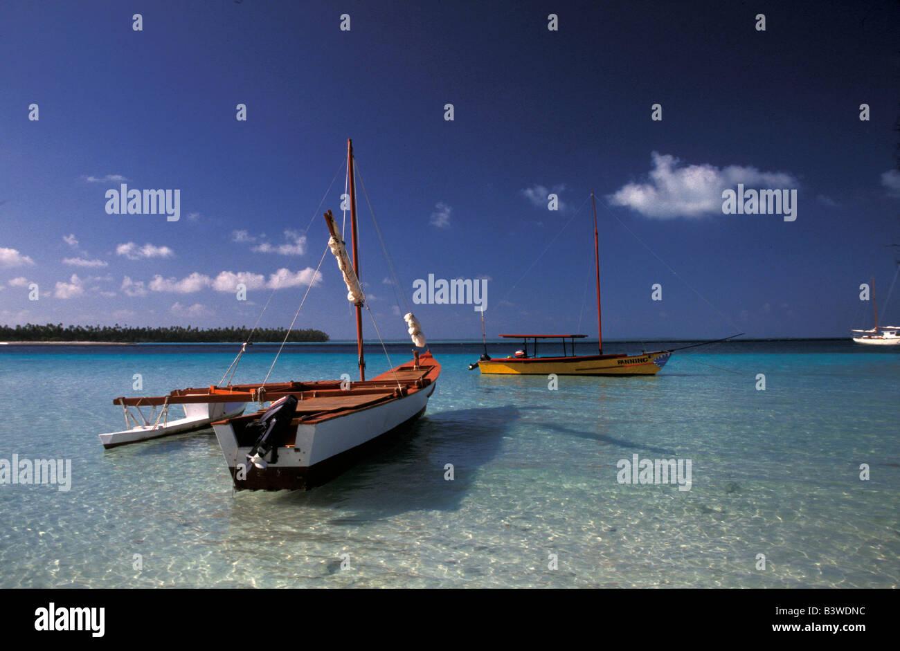 Oceania, Fanning Island, Kiribati. Sailboats, outrigger in harbor. - Stock Image