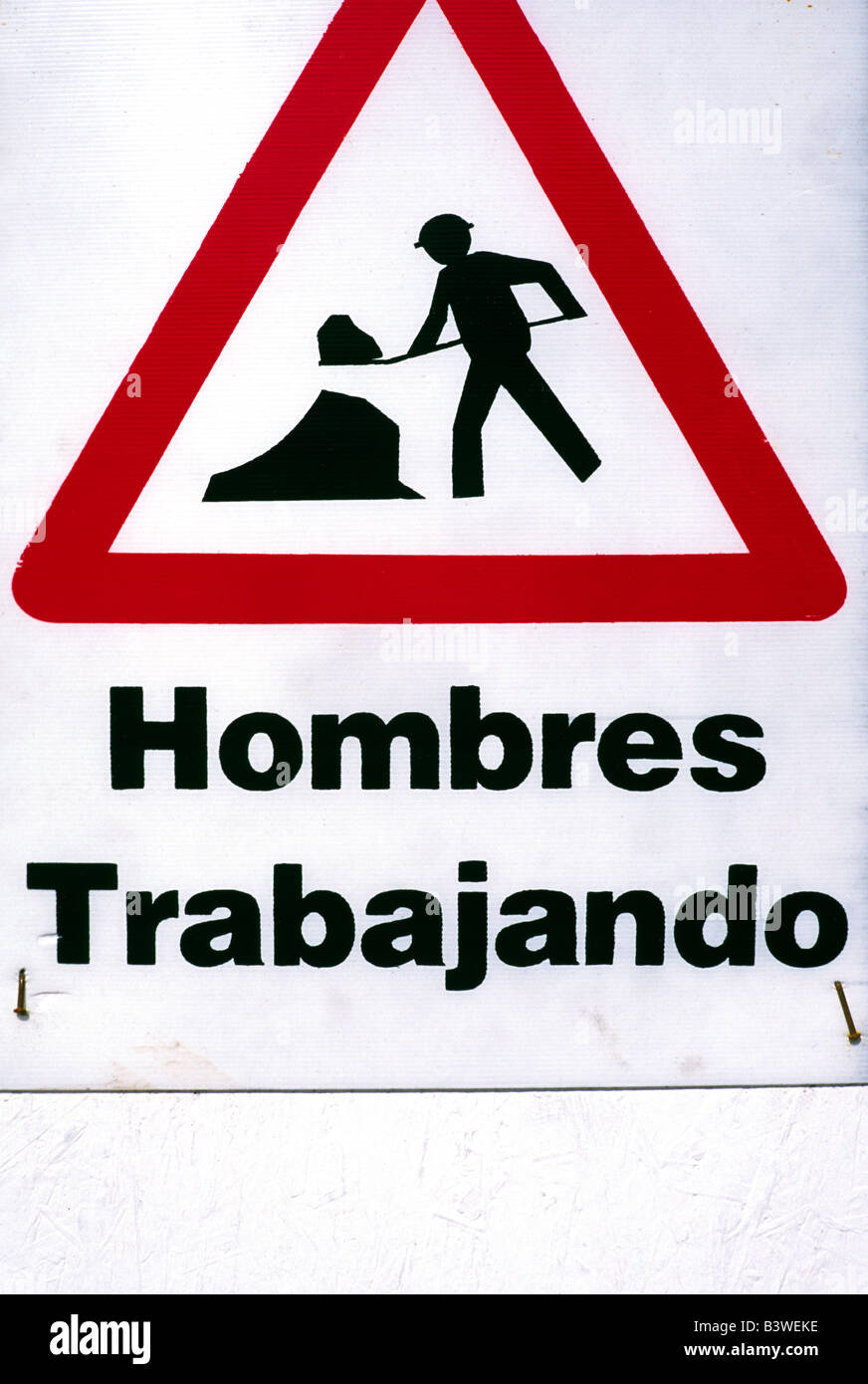 Buenos Aires, Argentina, Sign that says men working. - Stock Image