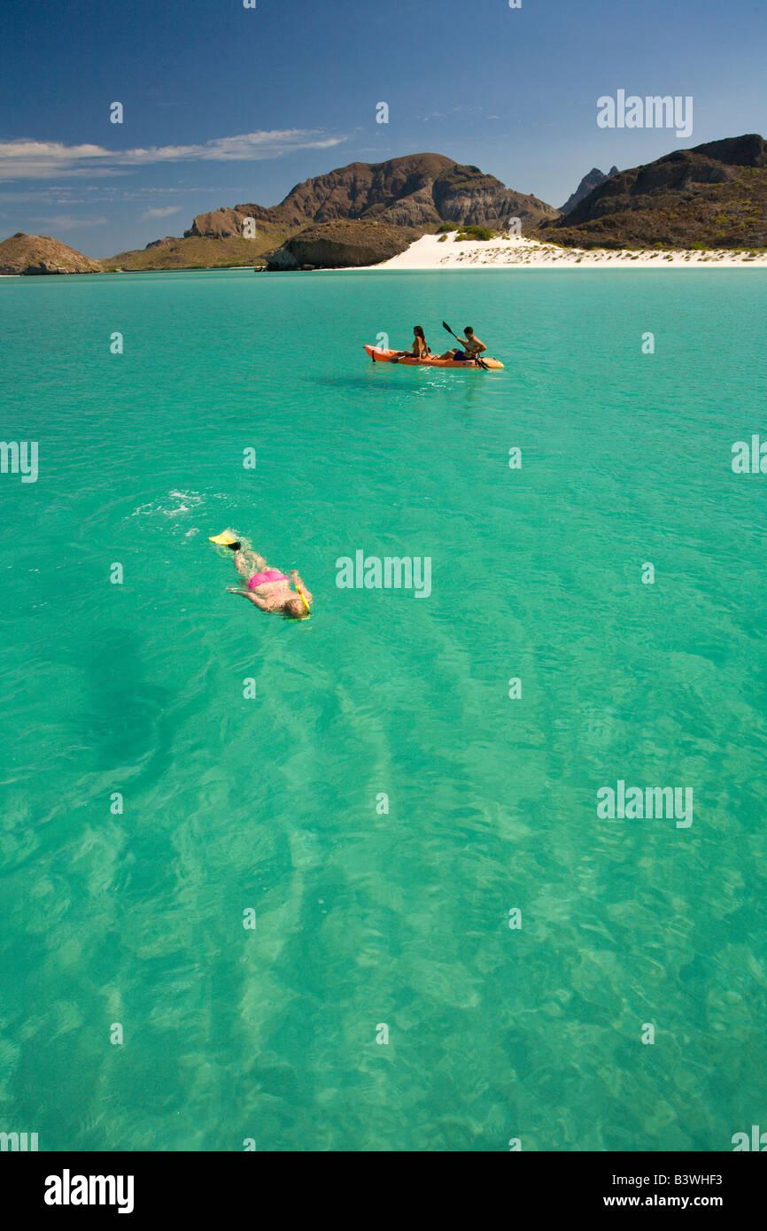 Model Released Hispanic Couple at Balandra Bay Beach near La Paz, Baja California, Mexico - Stock Image