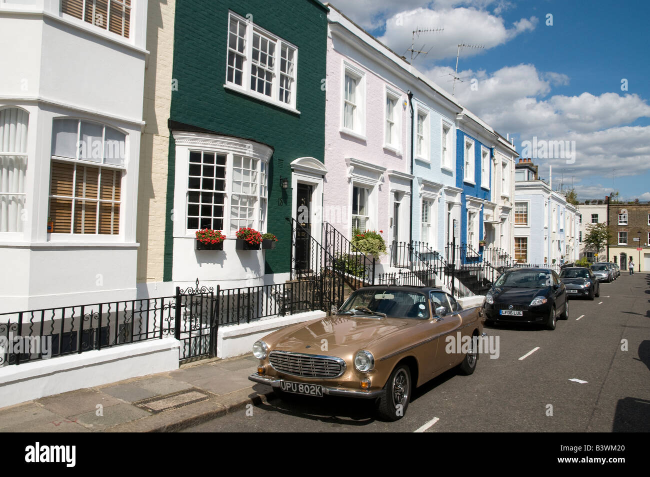 Row of expensive terraced houses in Hillgate Place, a residential street in Notting Hill, London England UK - Stock Image