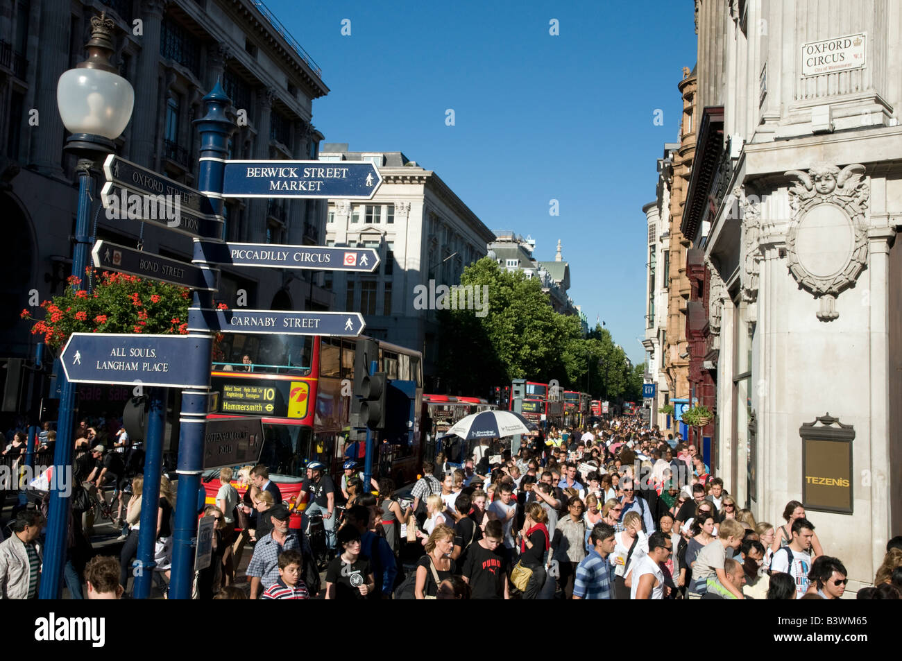 Crowds of shoppers on Oxford Street London England UK - Stock Image