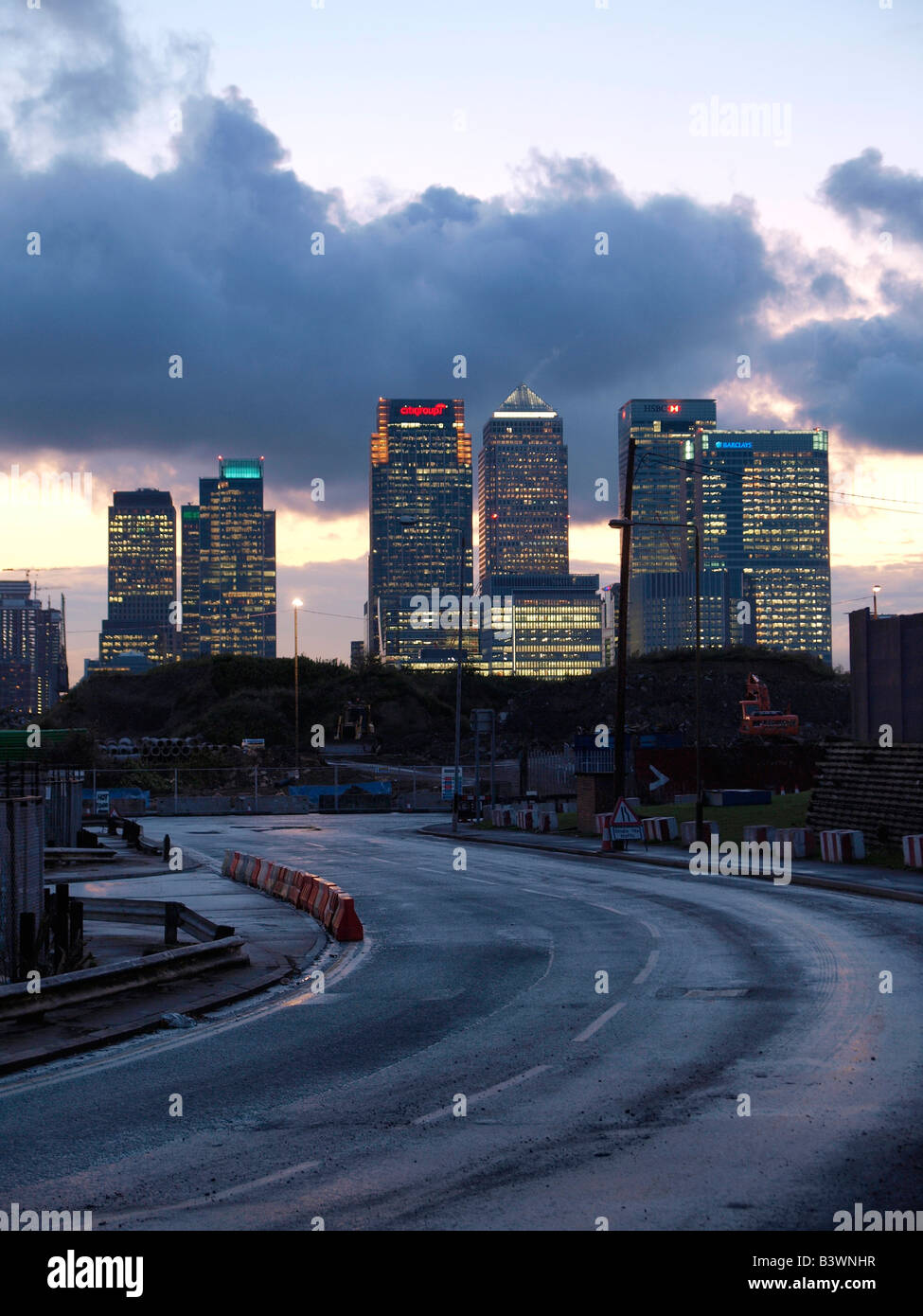 Canary Wharf bank buildings at night sunset with curvy road in front London UK - Stock Image