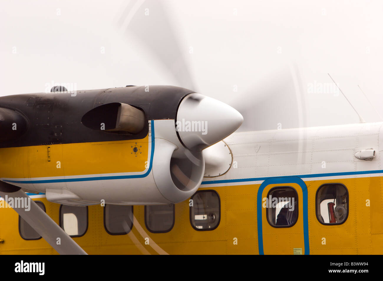 turboprop twin otter airplane engine spinning propeller - Stock Image