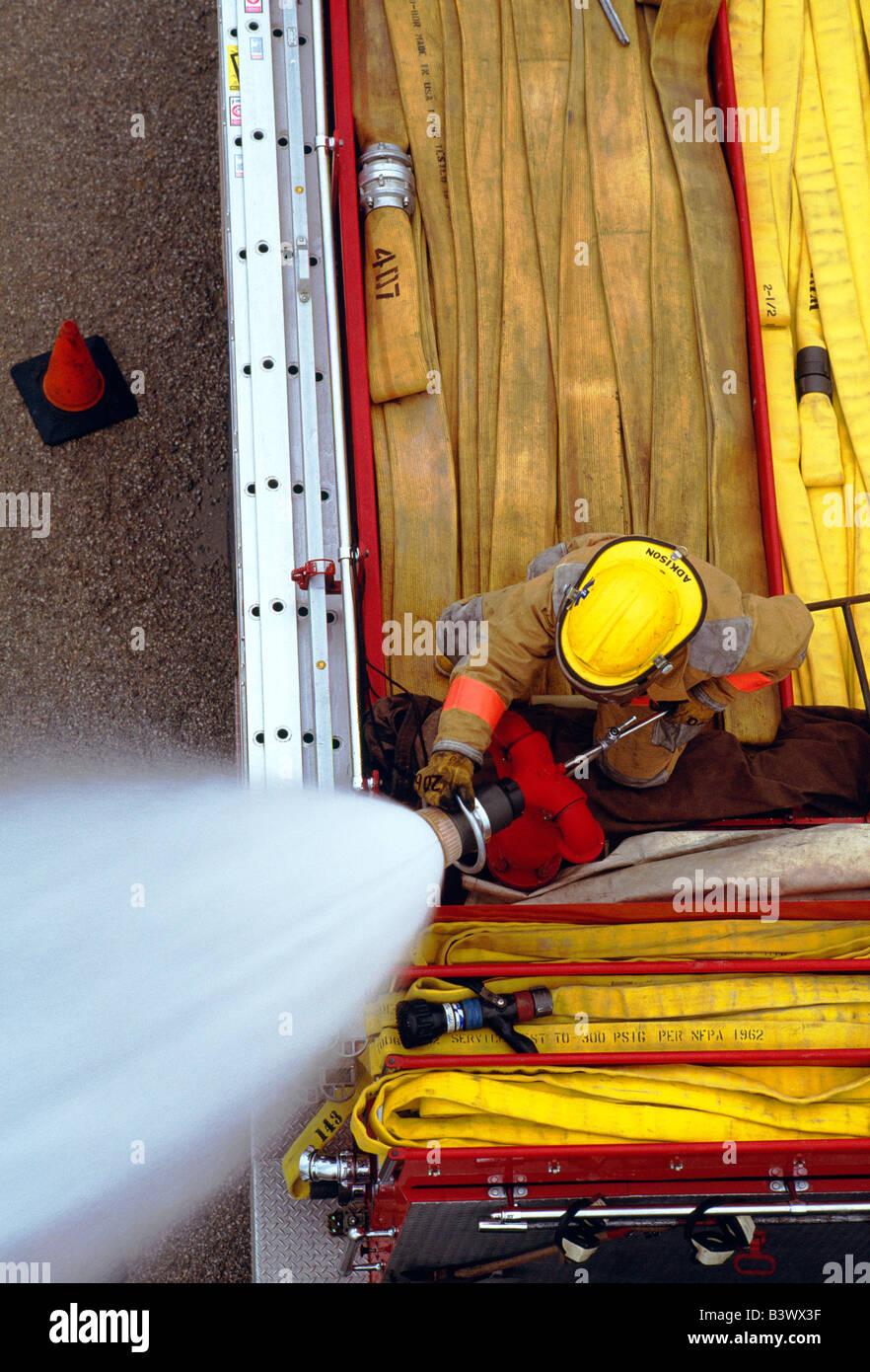 Fireman With Hose Stock Photos & Fireman With Hose Stock