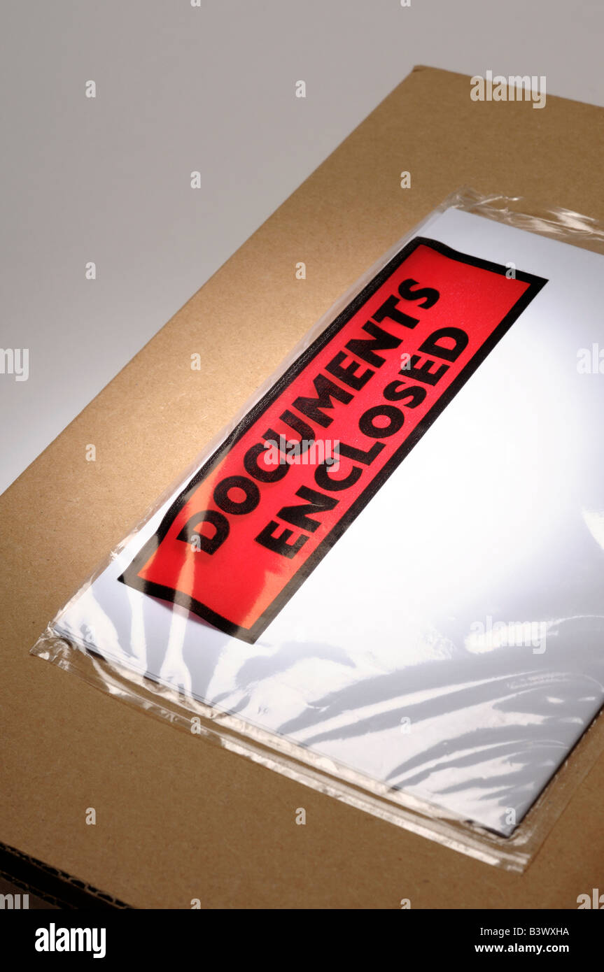 Cardboard box with documents enclosed - Stock Image