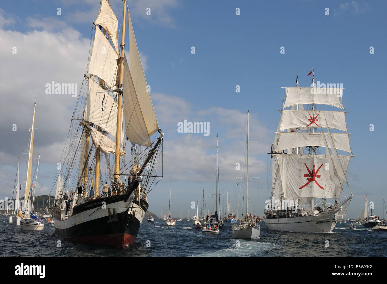 Shabab Oman a barquentine and the pelican of London at The start of the falmouth to portugal tall ships race - Stock Image