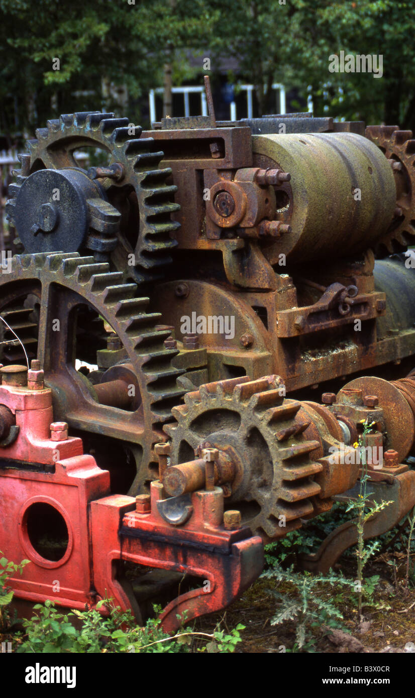 Industrial pump gearing in a state of dilapidation. - Stock Image