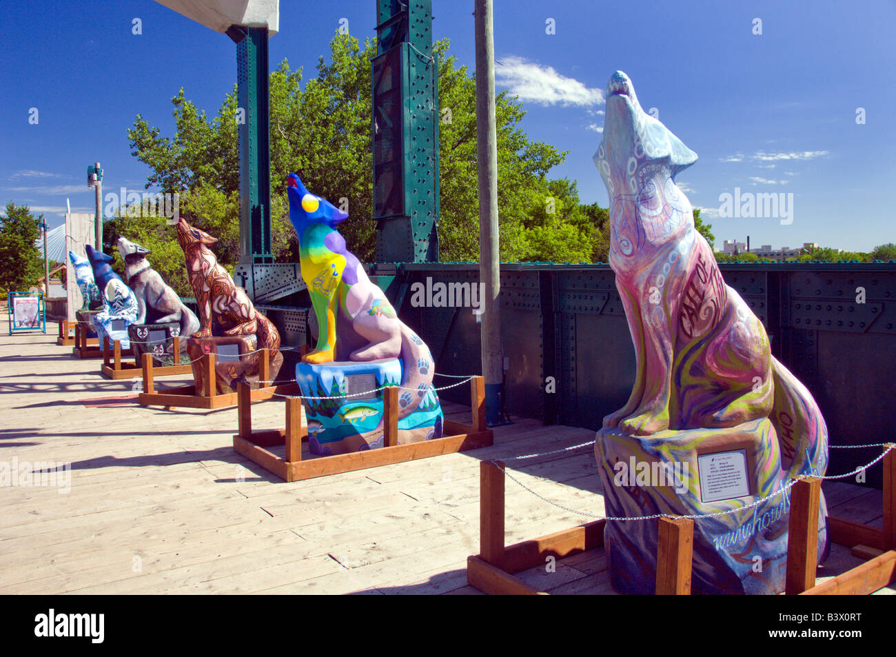 A row of concrete wolfe sculptures at The Forks in Winnipeg Manitoba Canada - Stock Image