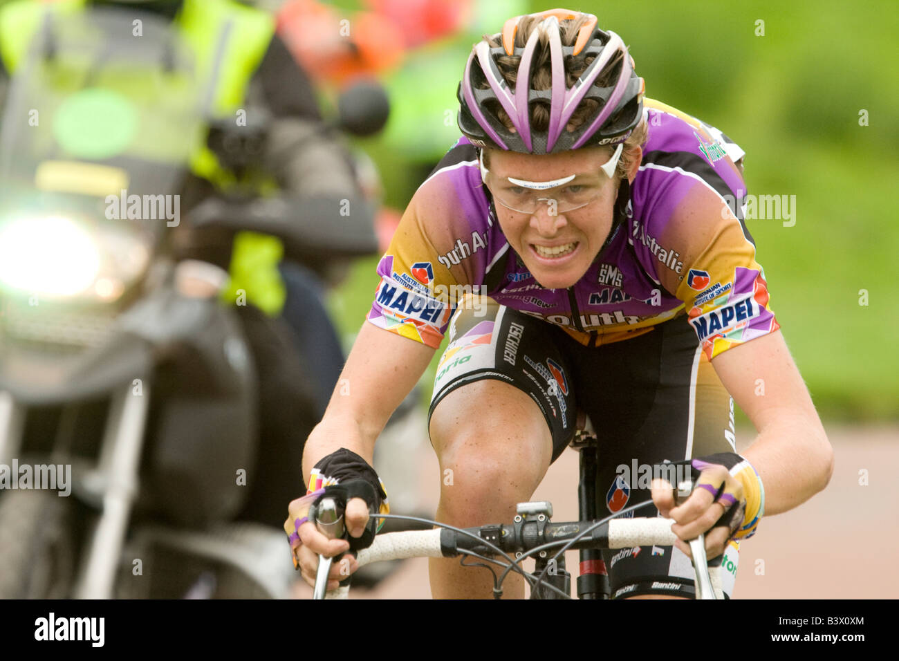 Tour of Britain cycle race rider gritting teeth as he races for finishing line at Drumlanrig Castle Scotland UK - Stock Image