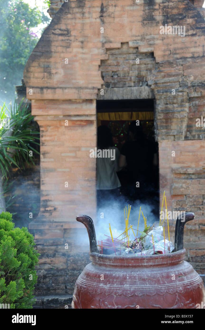 Incense burning in an urn at the Po Nagar Cham Towers Nha Trang  Vietnam - Stock Image