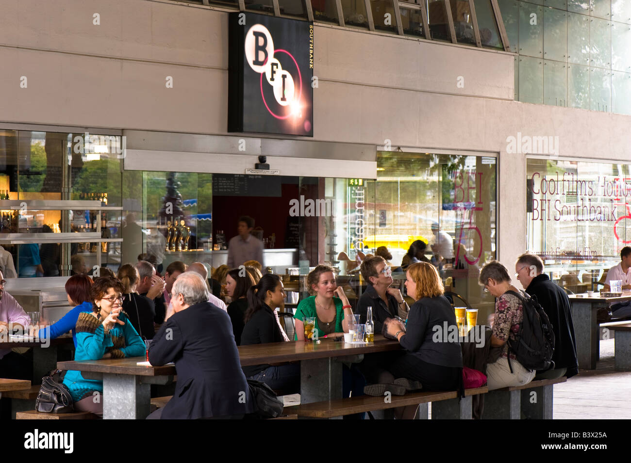 People enjoying a drink by British Film Institute Southbank London United Kingdom - Stock Image