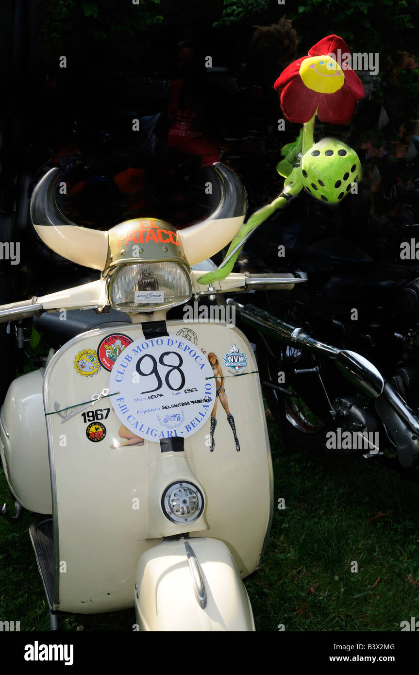 1967 Vespa scooter with horns and fluffy dice in Bellagio, Lake Como, Lombardy, Italy - Stock Image