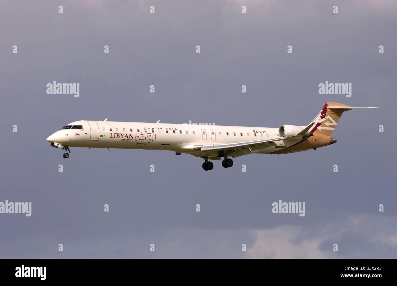 Libyan Arab Airlines Canadair Regional Jet CRJ 900 landing at London Heathrow - Stock Image