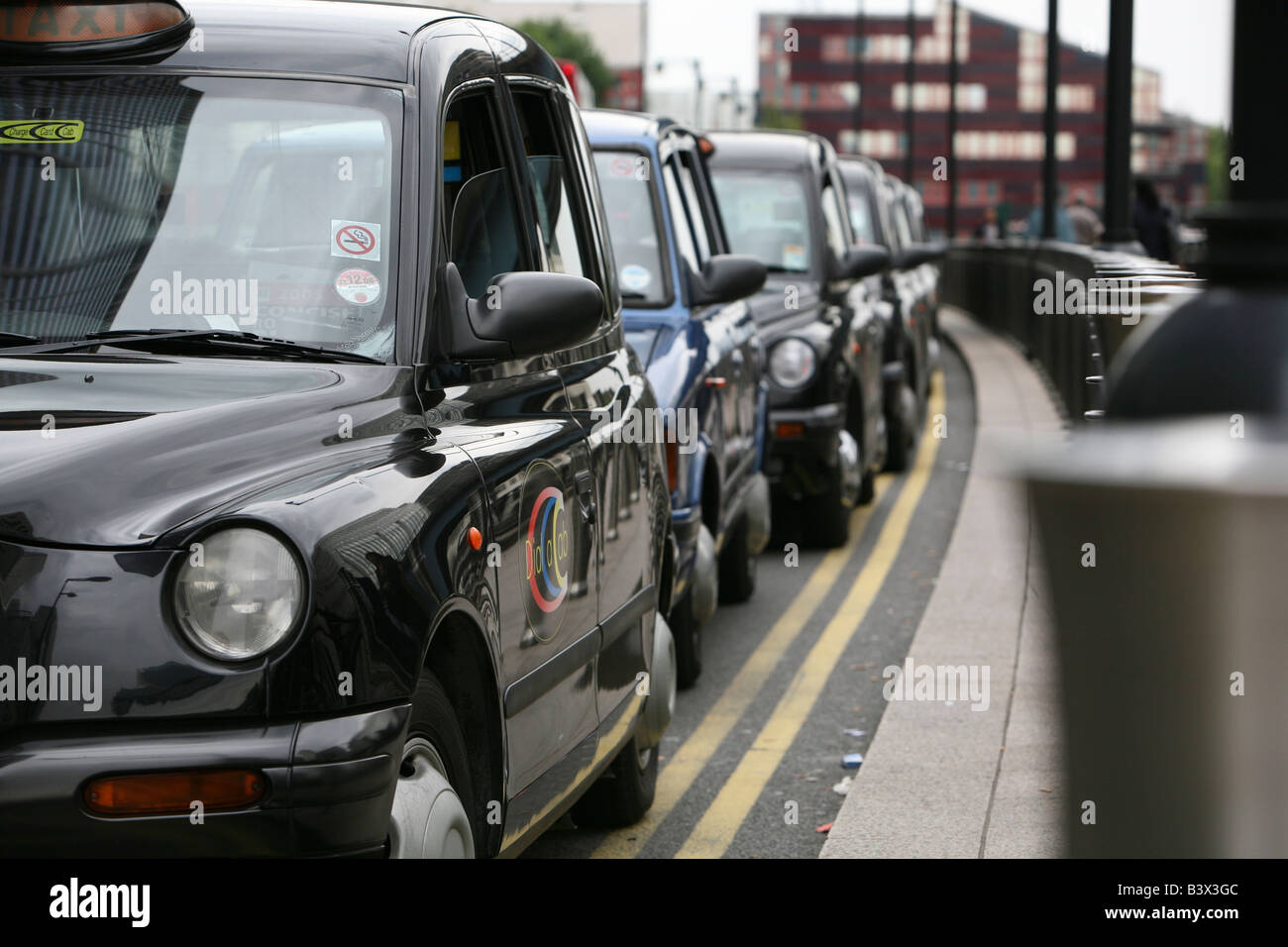 Taxi rank in a financial district. - Stock Image