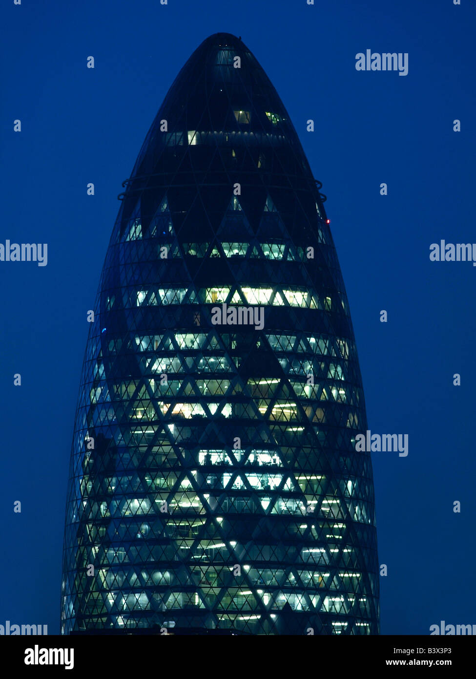 The Gherkin Swiss reinsurance building at night London UK - Stock Image