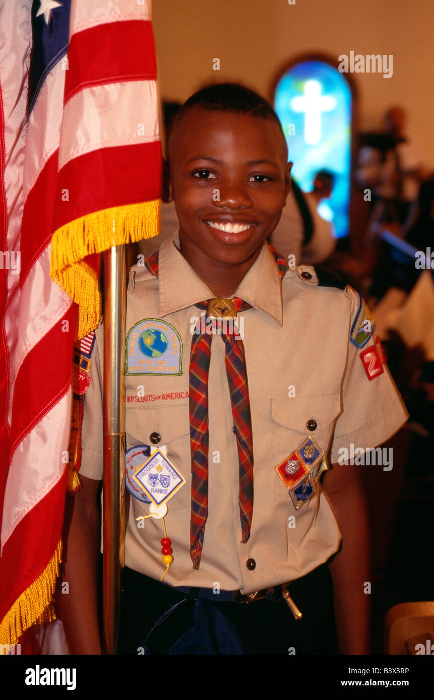 African American Cub scout with the American Flag, Gay's Hill Baptist Church, Millen, Georgia, USA - Stock Image
