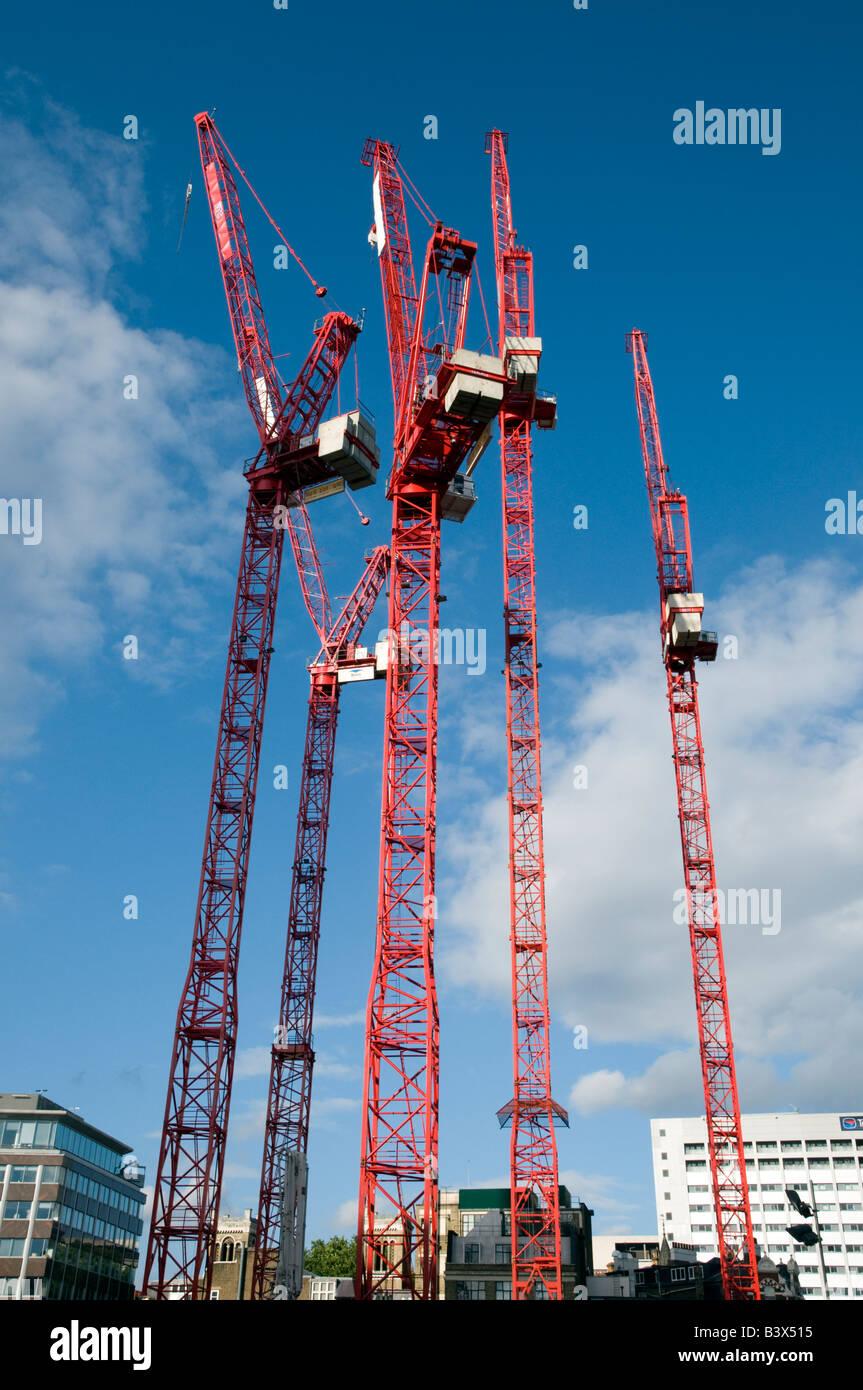 Red construction cranes London England UK - Stock Image