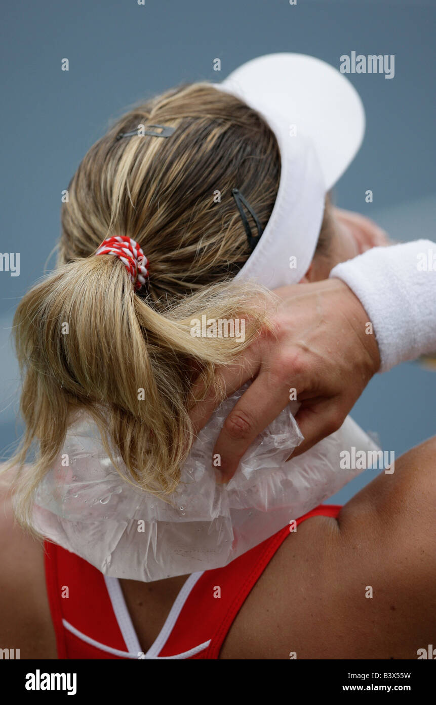 Tennis pro Nadia Petrova (RUS) cooling her neck with an ice pack. - Stock Image