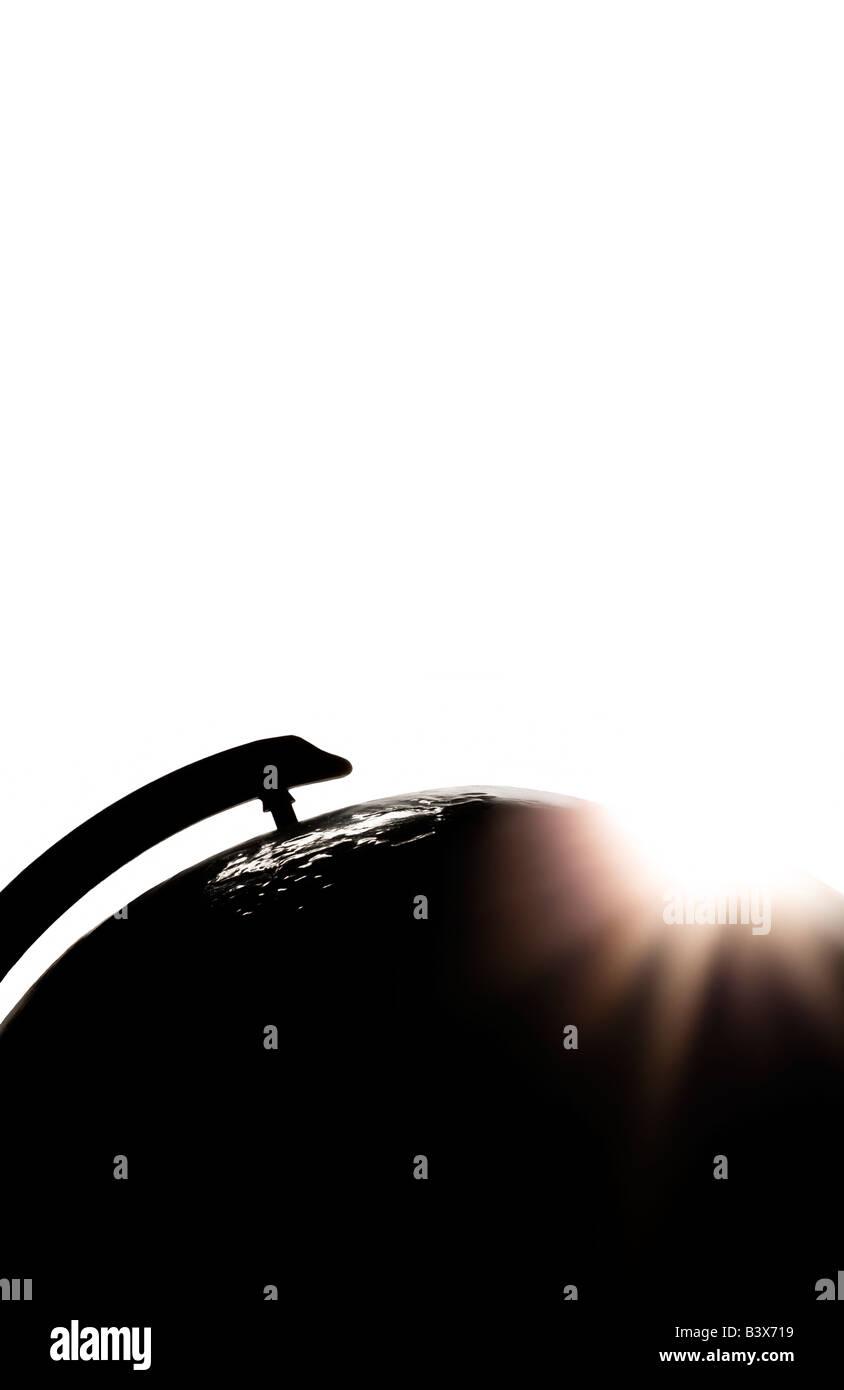 Sunlight over globe - Stock Image