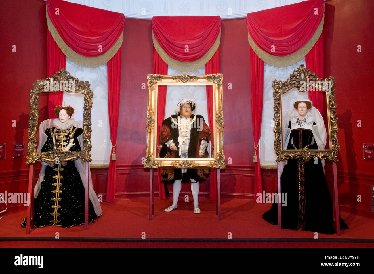 Waxwork models of Queen Elizabeth I Henry VIII and Queen Mary I at Madame Tussauds London, UK - Stock Image