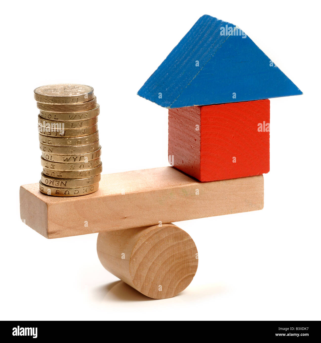 House and money seesaw - Stock Image