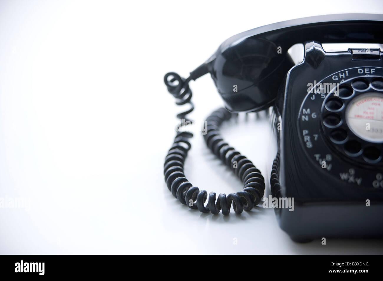 Studio Shot Of A Black Rotary Phone - Stock Image