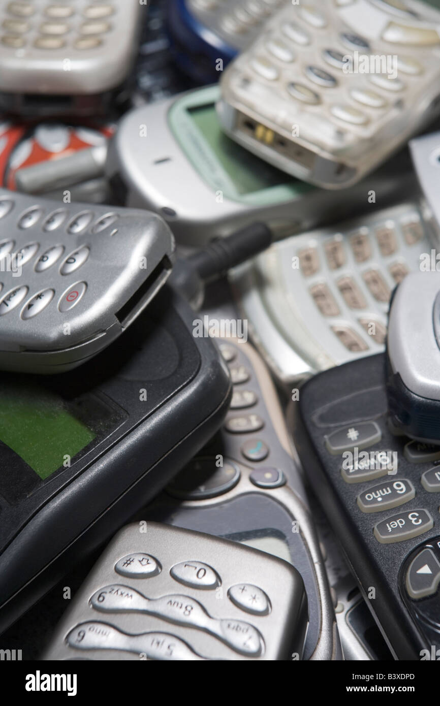 Pile Of Used Mobile Phones - Stock Image