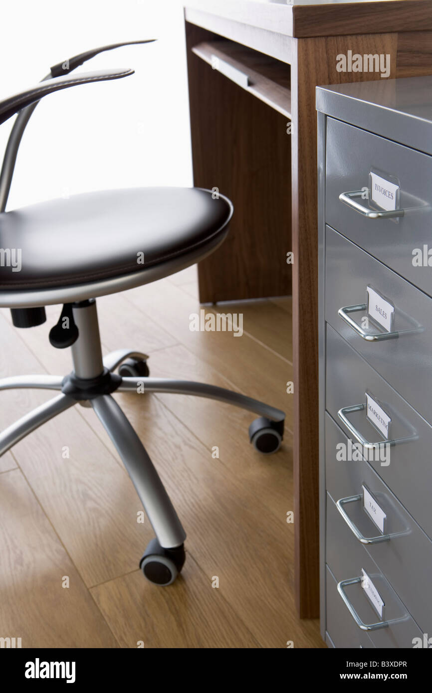 Empty Chair And Desk With Filing Cabinet - Stock Image