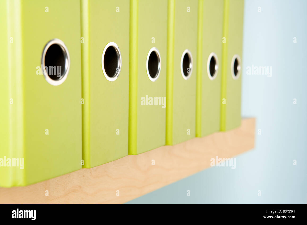 Row Of Green Ring Binders - Stock Image