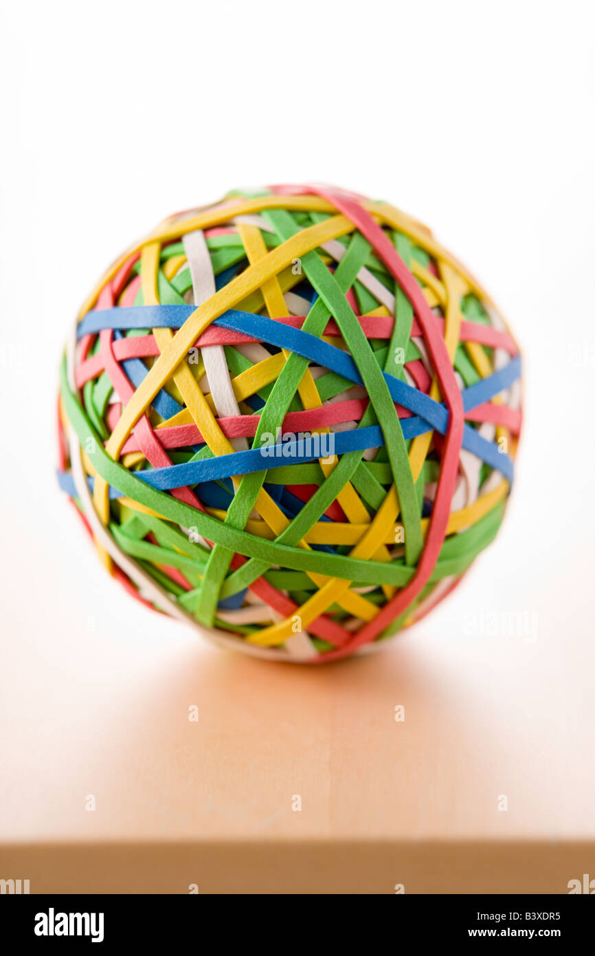 Rubber Band Ball Sitting On Desk - Stock Image