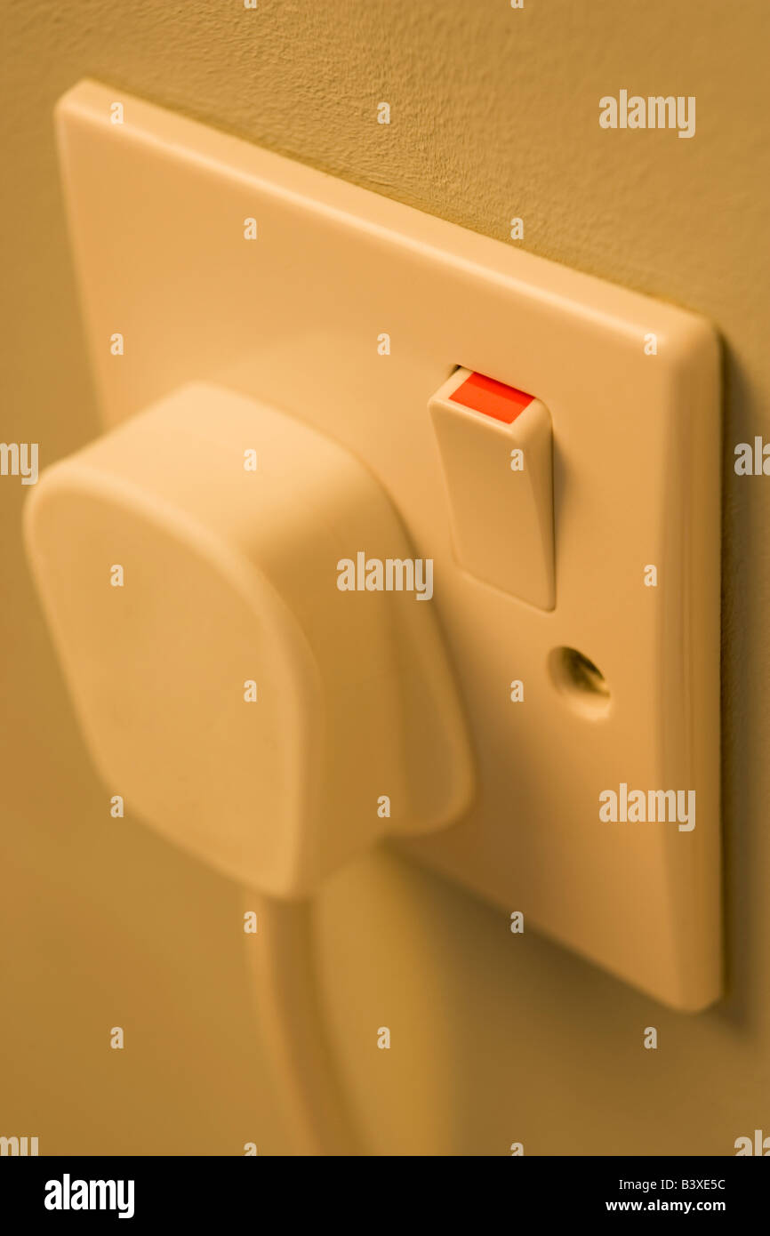 Electric Plug Connected To Outlet - Stock Image