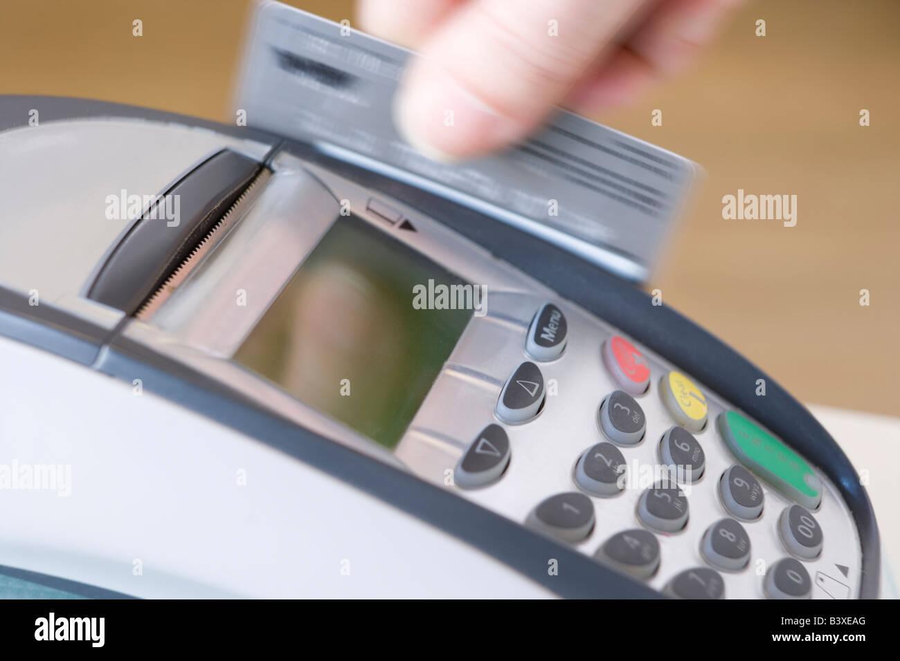 Swiping Credit Card - Stock Image