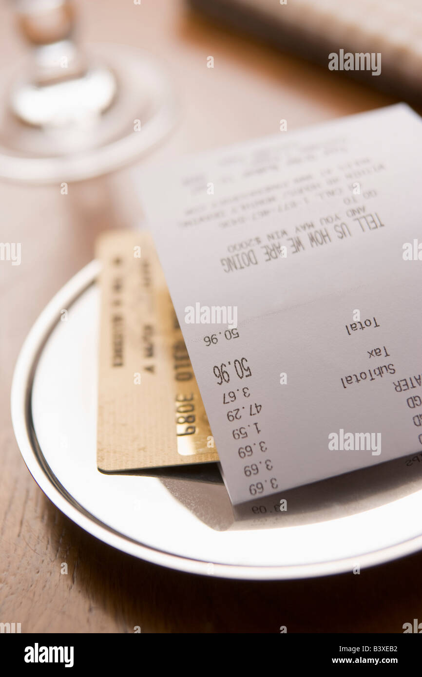 Paying Restaurant Bill With A Credit Card - Stock Image