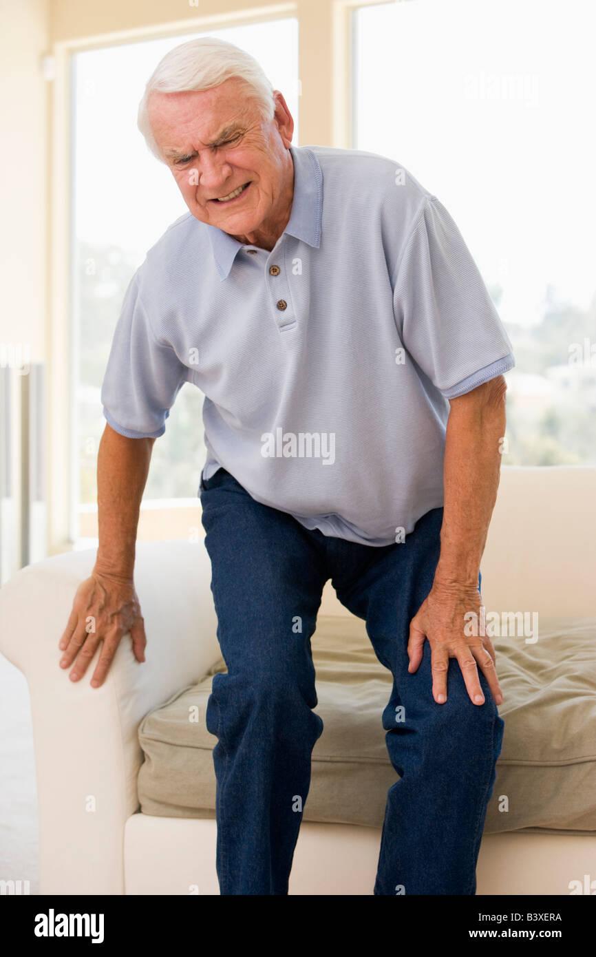 Senior Man Trying To Sit Down - Stock Image