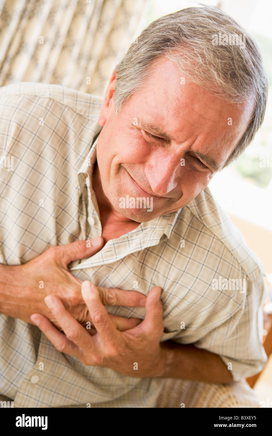 Man Clutching His Heart - Stock Image