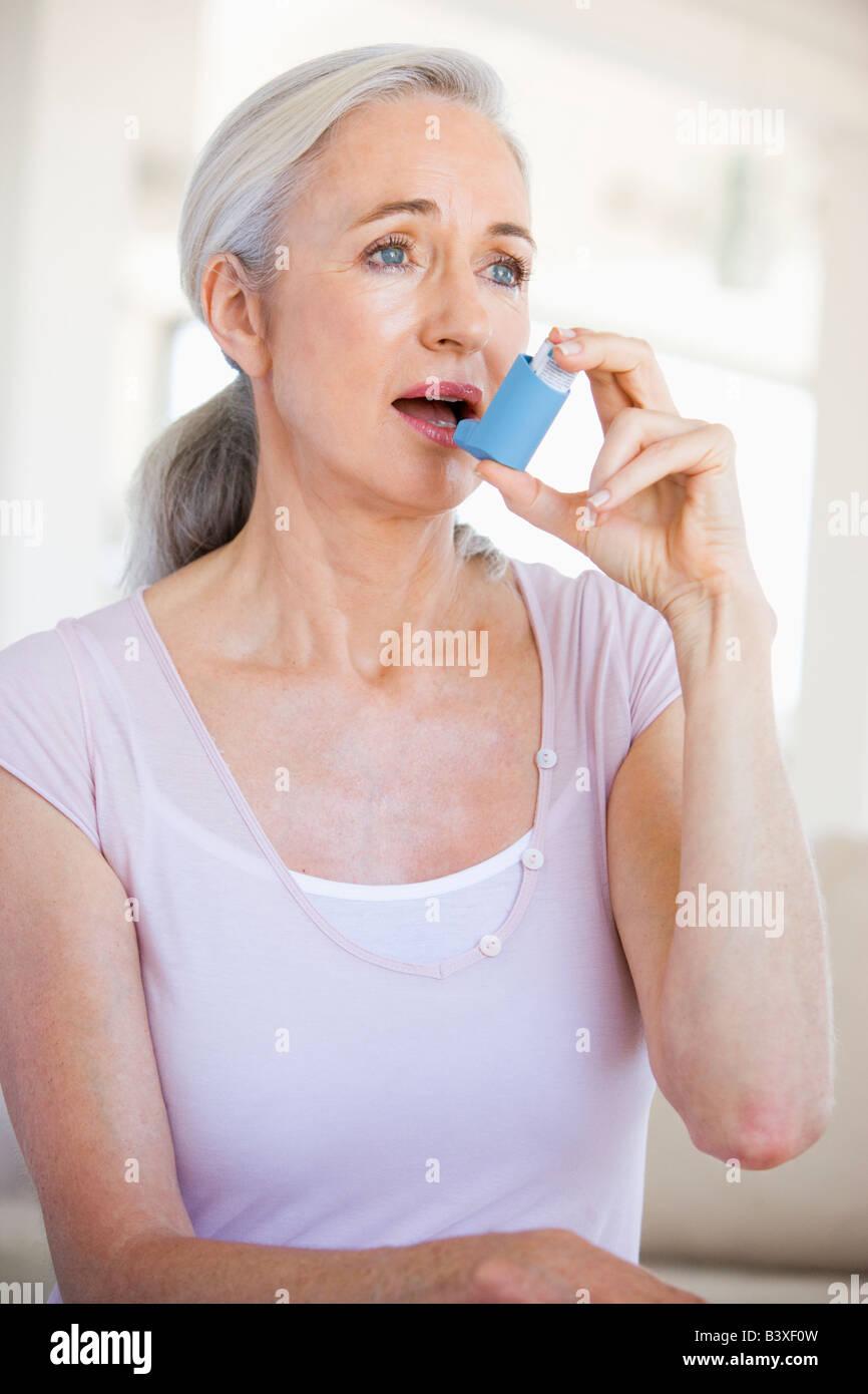 Woman Using An Inhaler - Stock Image