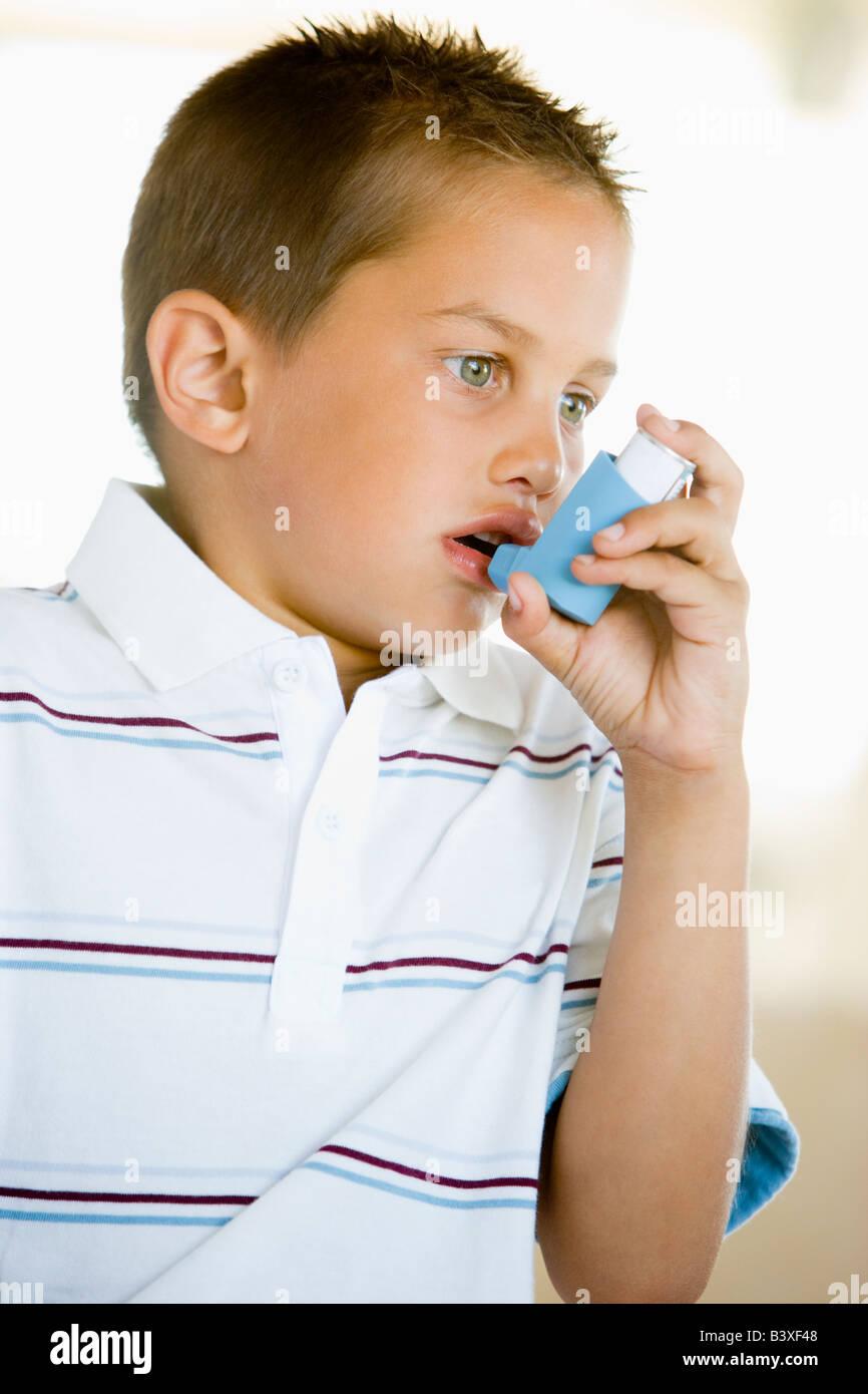 Boy Using An Inhaler - Stock Image