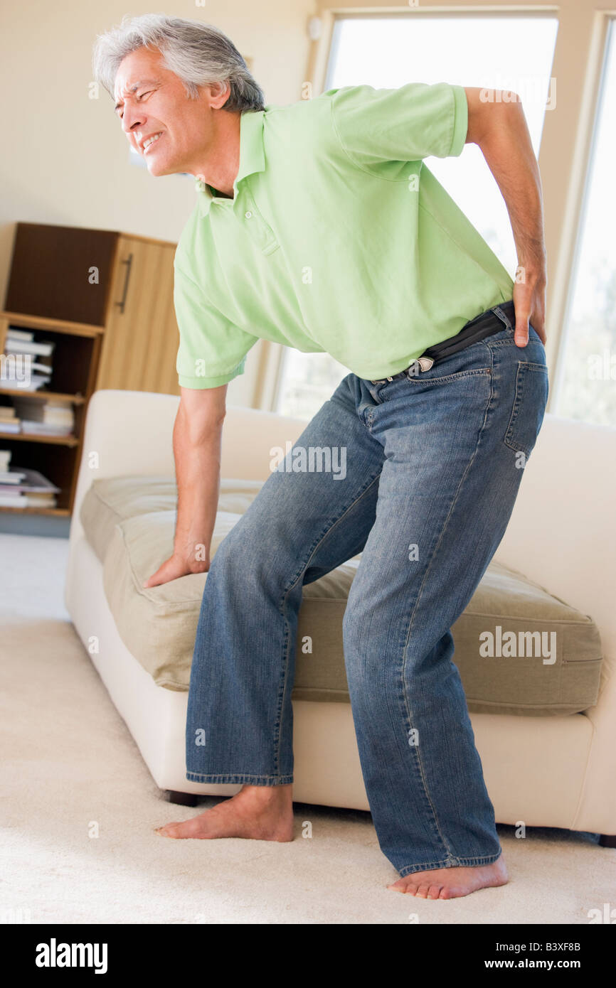 Man With Back Pain - Stock Image