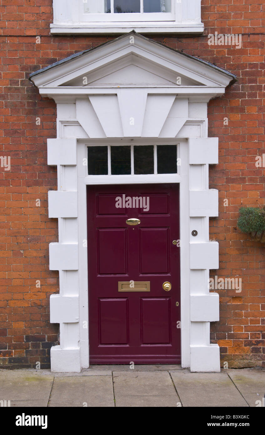 Maroon front door with glazed skylight and triangular pediment of townhouse in Ludlow Shropshire England UK & Maroon front door with glazed skylight and triangular pediment of ...